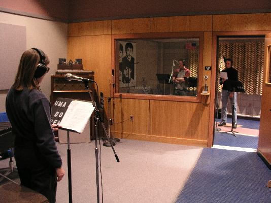 Dianne in the studio with students rehearsing and recording the script